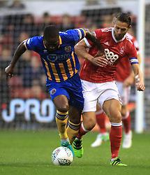 Shrewsbury Town's Abu Ogogo (left) and Nottingham Forest's Chris Cohen battle for the ball