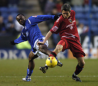 Photo: Jonathan Butler.<br />Leicester City v Cardiff City. Coca Cola Championship. 23/12/2006.<br />Kevin McNaughton of Cardiff fights Elvis Hammond of Leicester for the ball.