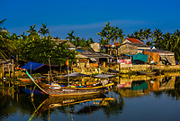 Fishing boats in a village along the Thu Bon River, near Hoi An, Vietnam.