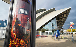 Glasgow, Scotland, UK. 23rd October 2021. Views of the site during final preparations with one week till opening  of UN Climate Change Conference UK COP26 which is being held in Glasgow in 2021. Pic ; Billboard with climate change warning in front of SEC venue.   Iain Masterton/Alamy Live News.
