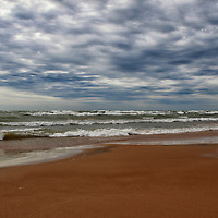 """""""Roll with the Sky""""<br /> <br /> Roll with the Sky! A quickly moving storm sky on Lake Michigan with strong waves crashing along the sandy beach!<br /> <br /> The Great Lakes by Rachel Cohen"""