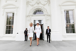 April 24, 2018 - Washington, District of Columbia, U.S. - MELANIA TRUMP and first lady of France BRIGITTE MACRON during arrival ceremony of the President of France. (Credit Image: ? White House via ZUMA Wire/ZUMAPRESS.com)