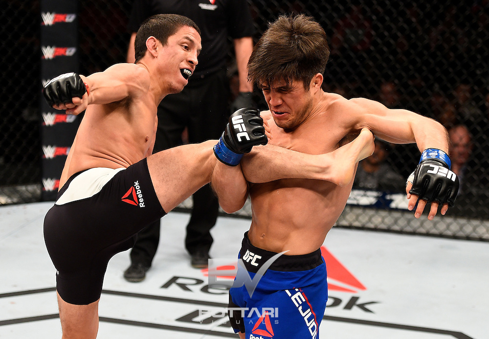 LAS VEGAS, NV - DECEMBER 03:  (R-L) Henry Cejudo attempts to take down Joseph Benavidez after catching a kick in their flyweight bout during The Ultimate Fighter Finale event inside the Pearl concert theater at the Palms Resort & Casino on December 3, 2016 in Las Vegas, Nevada. (Photo by Jeff Bottari/Zuffa LLC/Zuffa LLC via Getty Images)