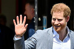 The Duke of Sussex waves to well-wishers as he leaves the OXSRAD Disability Sports and Leisure Centre, in Oxford.
