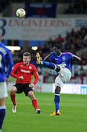 Ipswich Town's Guirane N'Daw ® clears from Cardiff's Aron Gunnarsson. NPower championship, Cardiff city v Ipswich Town at the Cardiff city Stadium in Cardiff, South Wales on Saturday 12th Jan 2013. pic by Andrew Orchard, Andrew Orchard sports photography,
