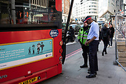 Having tried to do a three point turn on City Road, this bus reversed into a lampost, damaging both objects in London, England, United Kingdom.
