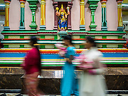 """22 OCTOBER 2015 - YANGON, MYANMAR: Hindus participate in a procession to honor the goddess Durga on the last day of Navratri in the Sri Kali temple in Yangon. Navratri, literally """"nine nights"""" is a Hindu festival devoted to the Goddess Durga. Navratri festival combines ritualistic puja (prayer) and fasting. Navratri in India follows the lunar calendar and is celebrated in September/October as Sharad Navratri. It's widely celebrated in countries in Southeast Asia that have large Hindu communities, including Myanmar (Burma). Many of Myanmar's Hindus are descendants of Indian civil servants and laborers who came to Myanmar when it was the British colony of Burma.   PHOTO BY JACK KURTZ"""