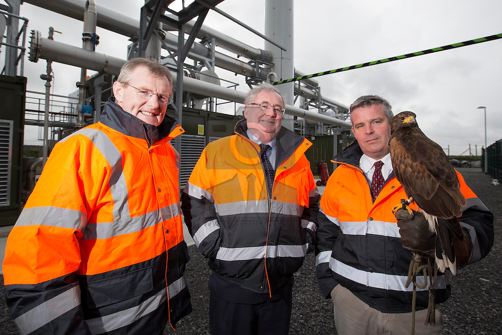 Repro Free: 07/04/2014 <br /> Pictured at the launch of the Bord naMóna Landfill Gas Utilisation Project in Drehid <br /> Co. Kildare is Gabriel D'Arcy, CEO, Bord naMóna, Pat Rabbitte TD Minister for Communication, Energy and Natural Resources and Garrett Leech, Environmental Manager, Resource Recovery, Bord naMóna with two of the Hawks utilized to maintain the landfill. Picture Andres Poveda