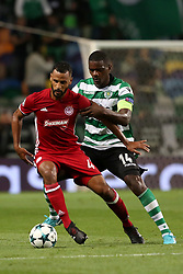 November 22, 2017 - Lisbon, Portugal - Olympiacos' midfielder Alaixys Romao vies with Sporting's midfielder William Carvalho from Portugal (R ) during the UEFA Champions League group D football match Sporting CP vs Olympiacos FC at Alvalade stadium in Lisbon, Portugal on November 22, 2017. Photo: Pedro Fiuza  (Credit Image: © Pedro Fiuza/NurPhoto via ZUMA Press)