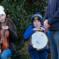 Musicians play at the grave side of Jim Guerin