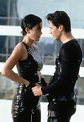 Sep 07, 2002; Hollywood, CA, USA; Actors CARRIE-ANNE MOSS as Trinity and KEANU REEVES stars as Neo in 'The Matrix' Directed by ANDY WACHOWSKI and LARRY WACHOWSKI..  (Credit Image: ZUMA Press/ZUMAPRESS.com) (Credit Image: © ZUMA Press/Entertainment Pictures/ZUMAPRESS.com)