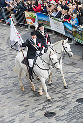 Edinburgh Riding of the Marches commemorates the return in 1513 of Randolph Murray clasping the Ancient Blue Blanket Banner with the tragic news of the defeat of the Scottish Army at the Battle of Flodden. 280 Horses traverse the boundaries of Edinburgh before culminating in a procession along the Royal Mile culminating in a ceremony celebrating the return of the flag at the historic Mercat Cross.<br /> <br /> Pictured: Edinburgh  Captain 2016 Paul Richards and Edinburgh Lass 2016 Cheryl McVay-Edwards