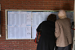 August 13, 2017 - Buenos Aires, Argentina - Women check a national voter registration list at a polling station during the primary vote day ahead of legislative elections in Argentina. (Credit Image: © Anton Velikzhanin via ZUMA Wire)