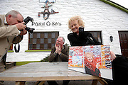 """Photographer Liam Mulcahy with Paidi O""""Se and Dr. Noelle Campbell-Sharpe at an auction of Liam's pictures in Ventry, County Kerry where all the proceeds went to the Irish Guide Dogs for the Blind. Liam who retired recently as staff photographer withg The Irish Independent donated the pictures which wer auctioned in the pub at the weekend.<br /> Picture by Don MacMonagle"""