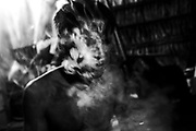 In October, 2015, Aladino is covered with smoke from a cigarette during a natural healing session. At the moment, he is inside his own home and completely connected to the spirits to perform the right move and cure the patient. Currently, the healing sessions are moment of truth for him. He is struggling all the time to prove that he still can be a powerful shaman, even after the surgery that almost killed him.