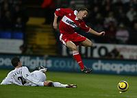 Photo: Chris Brunskill, Digitalsport<br />  Bolton Wanderers v Middelsborough. Barclays Premiership. 12/02/2005. Stewart Downing of Boro skips the challenge of Anthony Barness of Bolton.