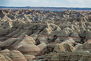 Erosion has exposed layers of ancient colorful sediments. Badlands National Park has the largest undisturbed mixed grass prairie in the United States. South Dakota, USA.
