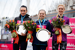 The winner of the women's Vitality Big Half race Charlotte Purdue (centre) alongside second placed Lily Partridge (left) and third placed Charlotte Arter (right) during the Vitality Big Half in London City Centre.