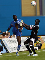 Photo: Olly Greenwood.<br />Gillingham v Swansea City. Coca Cola League 1. 16/09/2006. Gillingham's Clint Easton and Swansea's Kevin Amankwahh battle.