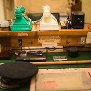 Rows of telephones at the desk of the Director of Plans, Admiralty, at the Churchill War Rooms in London. The museum, one of five branches of the Imerial War Museums, preserves the World War II underground command bunker used by British Prime Minister Winston Churchill. Its cramped quarters were constructed from a converting a storage basement in the Treasury Building in Whitehall, London. Being underground, and under an unusually sturdy building, the Cabinet War Rooms were afforded some protection from the bombs falling above during the Blitz.