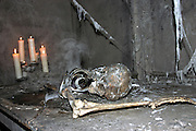 A skeleton is lying by some candles illuminating the path to the visitors of the London Dungeon, England, on Thursday, Oct. 12, 2006. The London Dungeon is a live theatre attraction where visitors are taken by the actors through different areas featuring the darkest parts of British history. Some of the more than 40 exhibits include 'The Great Fire of London', 'Jack the Ripper', 'Judgement Day', 'The Torture Chamber', 'Henry VIII', 'The Tower of London' and 'The French Revolution'. In 2003 a new part opened focused on the Great Plague of 1665.   **Italy Out**..