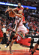 Chicago Bulls guard Derrick Rose (C) is fouled by Miami Heat guard Dwyane Wade and forward Udonis Haslem as he goes up for a shot during the fourth quarter of game 2 of the NBA Eastern Conference Finals at the United Center in Chicago on May 18, 2011.  (UPI)