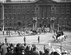 A general view of the scene at Buckingham Palace as King George VI and Queen Elizabeth leave with a sovereign's escort of Household Cavalry as they celebrate their silver wedding anniversary.