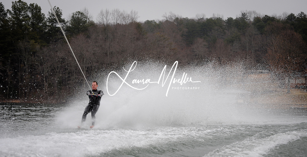 01/01/2011 Sherrills Ford, NC - Jeff Blair of Mooresville and his family have all grown up on water skis. He began skiing when he was 3 and entered the Annual Lake Norman New Years Day Barefoot Challenge for the first time in 1988..      Blair circled 3 times around at 39 mph with a time of 151 seconds. He began with a flying back dock start (which resembles a face plant into the water) and peppered his performance with a host of tricks, including tumble turns where he appears to hydroplane across the water while spinning on his back..      photo © Laura Mueller - www.lauramuellerphotography.com