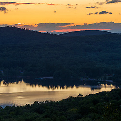 Sunset view of Crescent Lake from Pismire Bluff in the Raymond Community Forest in Raymond, Maine.