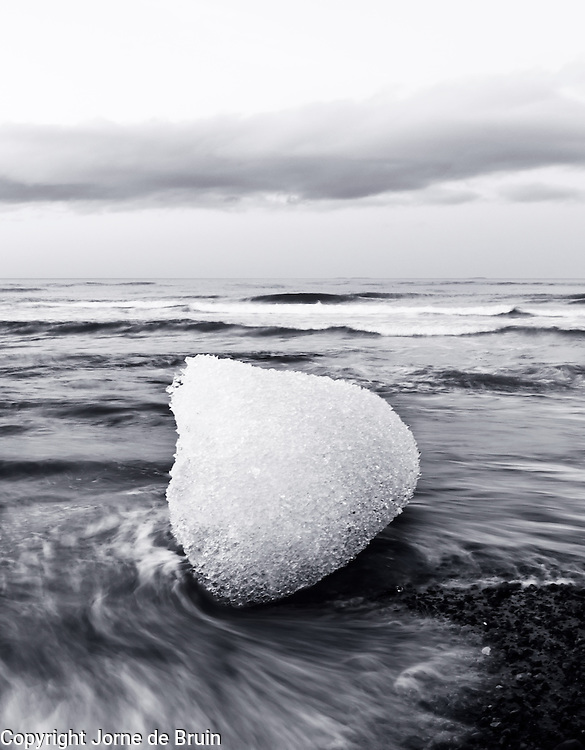 A small part of the Vatnajökull glacier is melting on the black beach of the atlantic coast in southern Iceland.