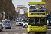 Tourist bus among traffic on Champs-Élysées in front of the Arc de Triomphe, Central Paris, France