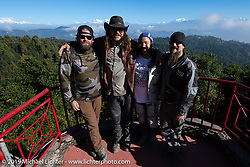 Tattoo artist Justin Big Meas Wilson, podcaster Danger Dan Hardick, co-leader Buddi Singh and Ledsled's Pat Patterson with white capped Himalayan Peaks behind them at the Everest Panorama Resort during Motorcycle Sherpa's Ride to the Heavens motorcycle adventure in the Himalayas of Nepal. Riding from Daman back to Kathmandu. Wednesday, November 13, 2019. Photography ©2019 Michael Lichter.