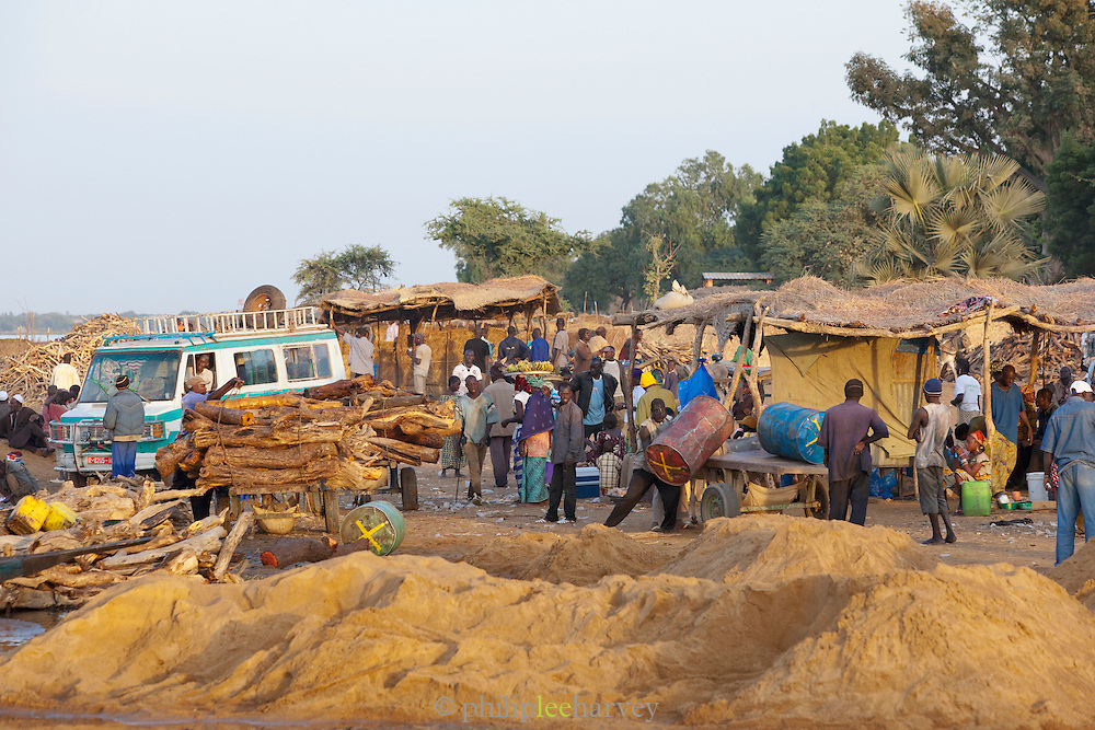 Many people working on the banks of the Niger River at Segou. Sand hauled from the bottom of the river will be used in construction across the country, Mali