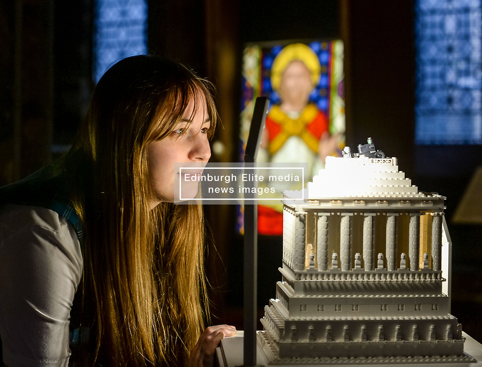 Cathedral steward Margaret Mary Tartaglia looks over one of the miniature recreations in the Lego Wonders exhibition in Glasgow Cathedral.<br /> <br /> © Dave Johnston / EEm