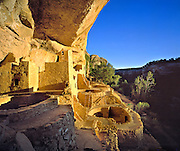 Sunset light enhances the Anasazi ruin of Cliff Palace, in Colorado's Mesa Verde NP, a World Heritage Site.