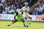Bacary Sagna of Manchester city holds off Jefferson Montero of Swansea city (r). Barclays Premier league match, Swansea city v Manchester city at the Liberty Stadium in Swansea, South Wales on Sunday 15th May 2016.<br /> pic by Andrew Orchard, Andrew Orchard sports photography.