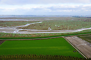 Nederland, Zeeland, Zeeuws-Vlaanderen, 23-10-2013; Van rechts naar links onder in beeld: Belgische Prosperpolder en reeds onder water gezet, daarnaast De Hedwige Polder en tenslotte een klein stukje van Het Verdronken Land van Saeftinge. Aan de horizon de Belgische kant van de Westerschelde naar de Haven van Antwerpen. <br /> Borderland Belgium and the Netherlands, the Drowned Land Saeftinge and the Hedwige Polder (bottom). On the horizon the entrance og the port of Antwerp. <br /> luchtfoto (toeslag op standaard tarieven);<br /> aerial photo (additional fee required);<br /> copyright foto/photo Siebe Swart.