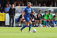 AFC Wimbledon midfielder Scott Wagstaff (7) dribbling during the EFL Sky Bet League 1 match between AFC Wimbledon and Scunthorpe United at the Cherry Red Records Stadium, Kingston, England on 15 September 2018.