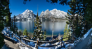 Snowy Teton peaks reflect in Jenny Lake, Grand Teton National Park, Wyoming, USA. This image was stitched from multiple overlapping photos.