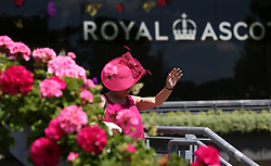 A female racegoer during day three of Royal Ascot at Ascot Racecourse.