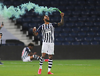 Football - 2019 / 2020 Championship - West Bromwich Albion vs Queens Park Rangers<br /> <br /> Matt Phillips of WBA celebrates promotion with a flare   , at the Hawthorns.<br /> <br /> Credit: COLORSPORT/ANDREW COWIE