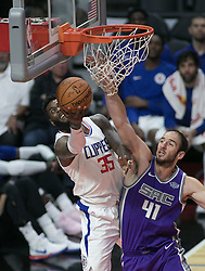October 12, 2017 - Los Angeles, California, U.S - Willie Reed #35 of the Los Angeles Clippers goes for a  reverse layup during their preseason game against the  Sacramento Kings Thursday October 12, 2017 at the Galen  Center in USC in Los Angeles, California. Clippers defeat  Kings, 104-87. (Credit Image: © Prensa Internacional via ZUMA Wire)