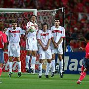 Korea's Eul Yong Lee's free kick sails over the Turkish wall to score Korea's first goal