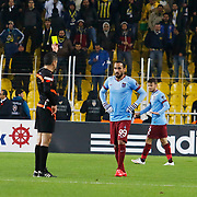 Referee's Bulent Yildirim show the yellow card to  Trabzonspor's Erkan Zengin during their Turkish superleague soccer derby Fenerbahce between Trabzonspor at the Sukru Saracaoglu stadium in Istanbul Turkey on Saturday 07 February 2015. Photo by Aykut AKICI/TURKPIX
