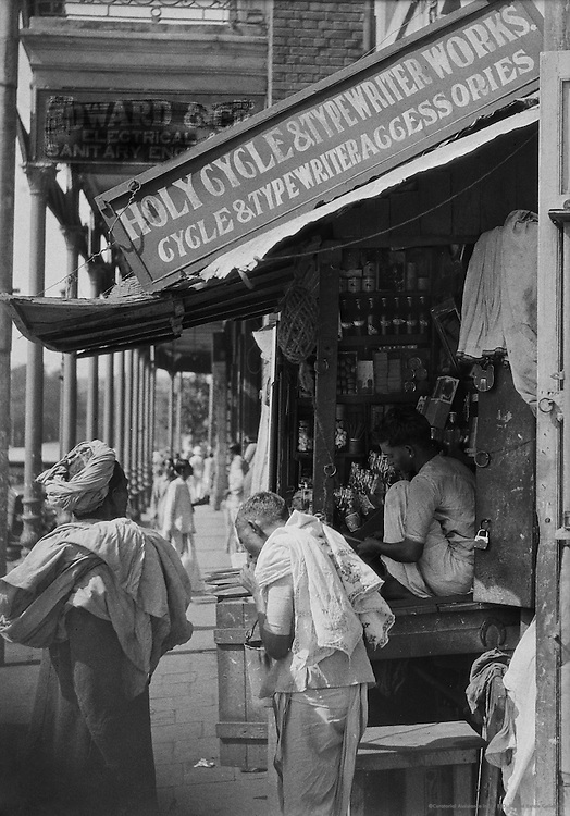 Holy Cycle & Typewriter Works Stall, Lal Bazaar Street, Calcutta, India, 1929