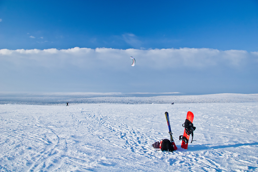 Paragliders prepare for takeoff in Lapland, Finland.