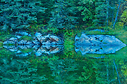 Reflection in Middle Lake at dusk<br />Kenora<br />Ontario<br />Canada