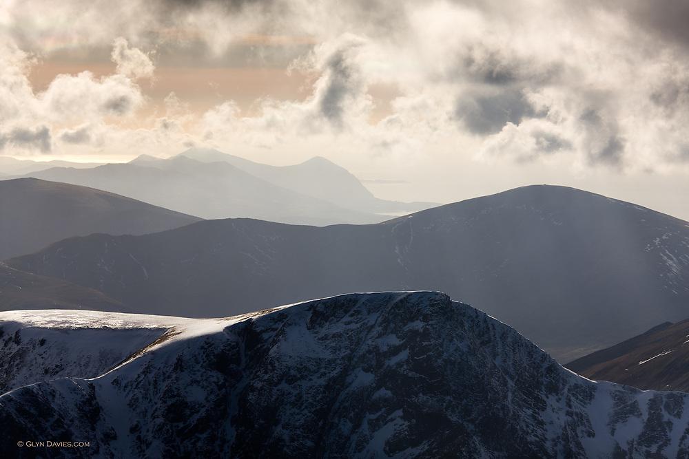 The Llyn Peninsula in winter, seen from Northern Snowdonia, looking across the lower ridges of Snowdon, Foel Gron, Foel Goch, Moel Eilo, Mynydd Mawr, then Bwlch Mawr and Yr Eifl ib the far distance.