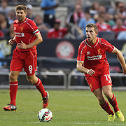 Jordan Henderson, (right), and Steven Gerrard, Liverpool, in action during the Manchester City Vs Liverpool FC Guinness International Champions Cup match at Yankee Stadium, The Bronx, New York, USA. 30th July 2014. Photo Tim Clayton