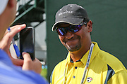 June 12 2013: Michael Campbell smiles as a fan takes a camera phone photo of him during the wednesday practice round at the 2013 U.S. Open hosted by Merion Golf Club in Ardmore, PA.